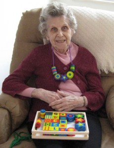Bernice with her beads | Activities for dementia