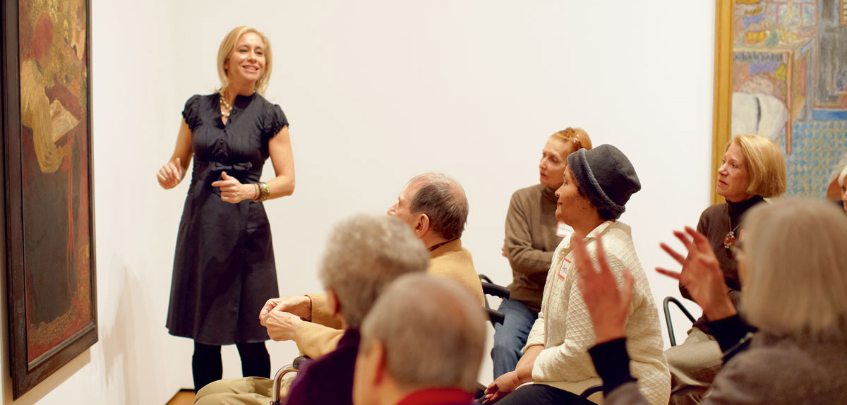 Francesca Rosenberg leads people with Alzheimer's and their caretakers in a discussion at the Museum of Modern Art.  ~ Jason Brownrigg - Photograph courtesy of artnews.com