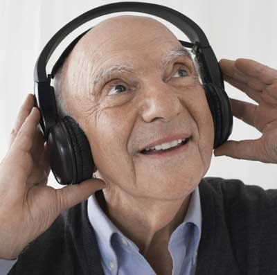 activities for Alzheimer's disease | An elderly man enjoying music