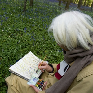 Creating Art as Therapy for Alzheimer's | Elderly woman painting in a notebook