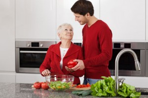 Older woman getting help with cooking
