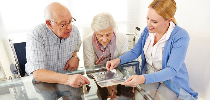 Older couple reminiscing with photo album